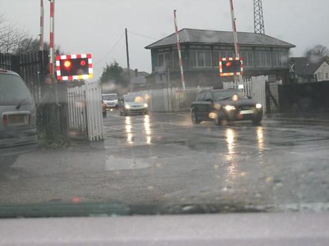 Motorist caught driving through warning lights. Farncombe West level crossing, Surrey