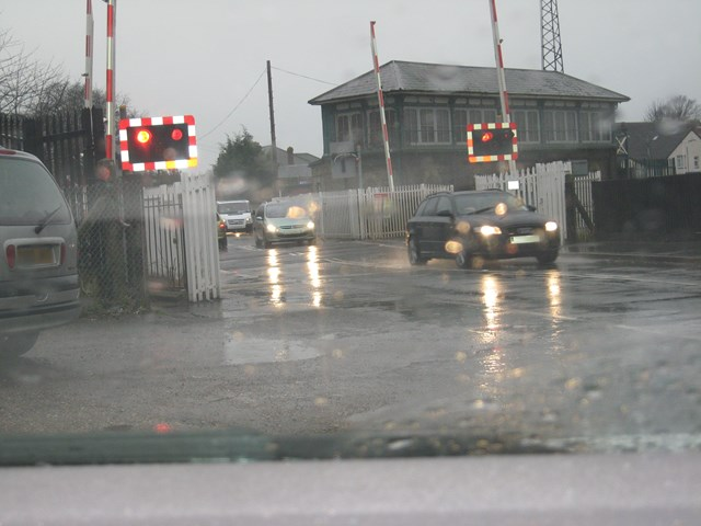 Motorist caught driving through warning lights. Farncombe West level crossing, Surrey