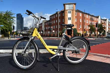 CYCLOPS launch Hulme: Close up shot of a branded Bee bike parked on a stand at the new CYCLOPS junction in Hulme.