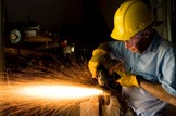 Business-industry-construction-welding: iStock - File #4364647 - 'Industry: Man Grinding in workshop wearing hardhat and gloves' - 24-09-2008