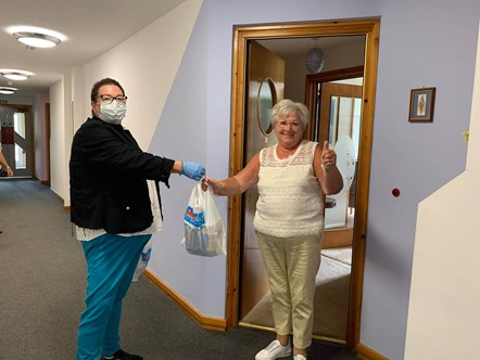 74 year-old Janet receives lunch from Christine from Buckie Central East Locality Group