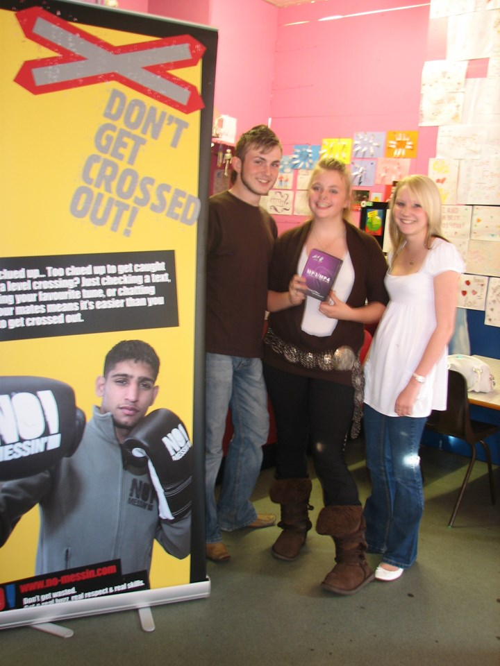 St Neots Teen Toni Wigley (centre) Wins No Messin'! Competition: St Neots Teenager Toni Wigley (centre) with friends at the local youth club. Toni collects her prize after winning a No Messin'! competition