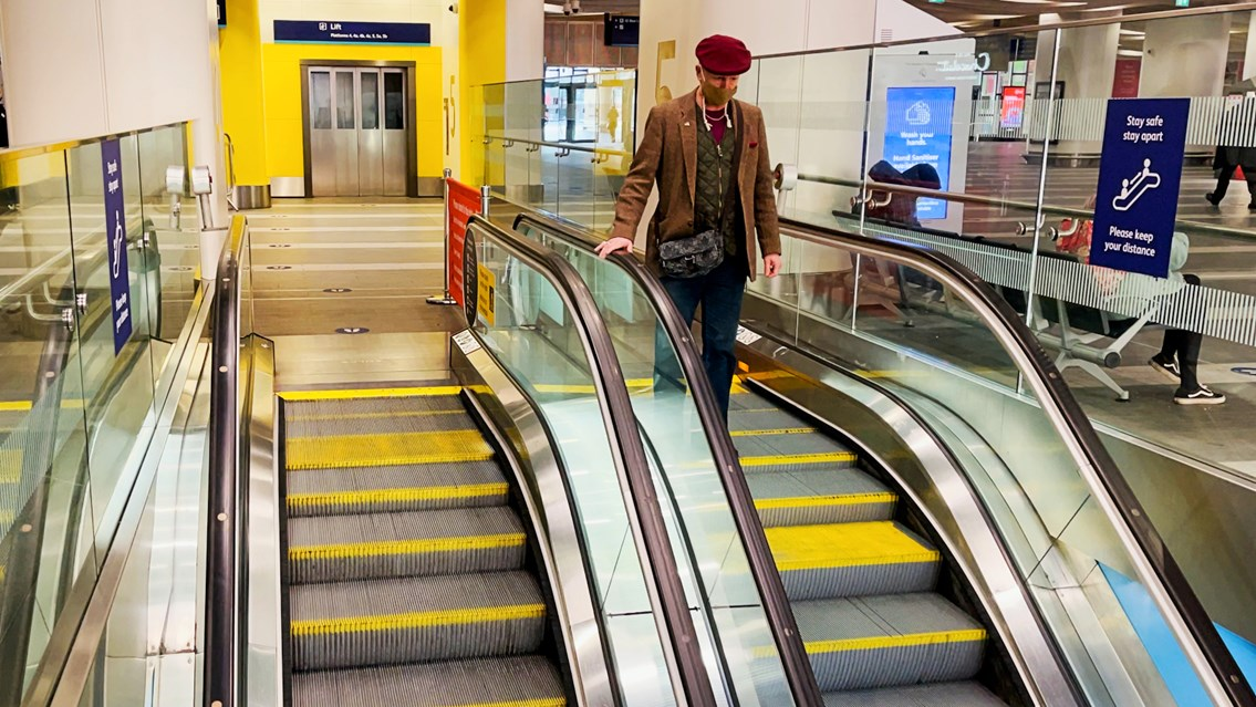 Tests show no traces of Covid-19 at Birmingham New Street station: Birmingham New Street escalator handrail stock shot