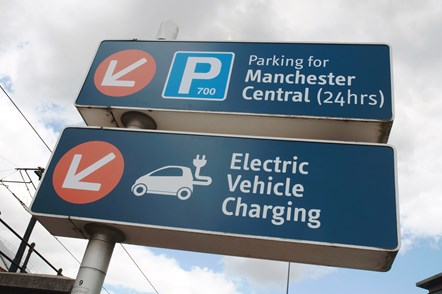 Electric vehicle charging point signage: Electric vehicle charging point signage outside Manchester Central car park, Manchester.