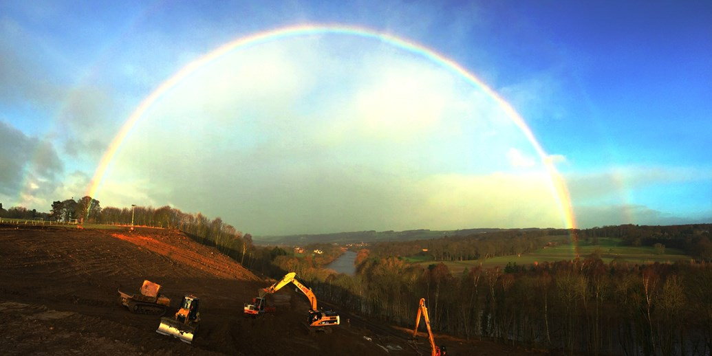 Trains to resume on Monday after West Line landslip repairs: A rainbow over the site at Farnley Haugh