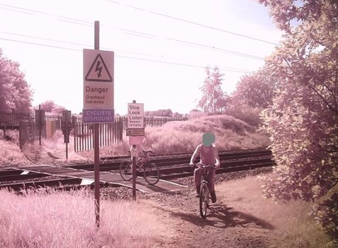 Children cycling on Penny's level crossing
