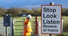 stop look listen level crossing sign: level crossing