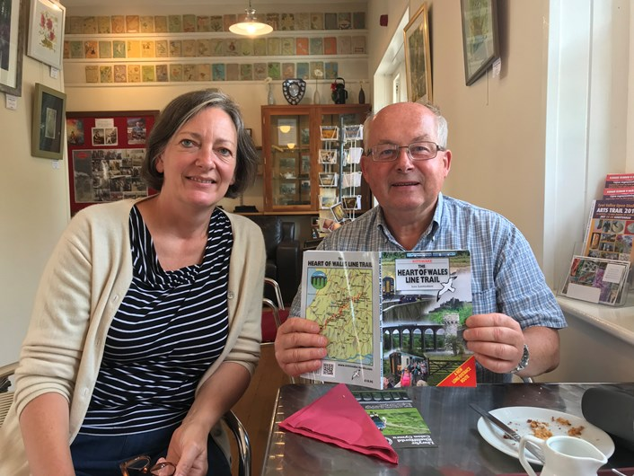 Lisa Dennison, Development Officer at the Heart of Wales Community Rail Partnership pictured with a visitor to the area who recently purchased the walking trail book