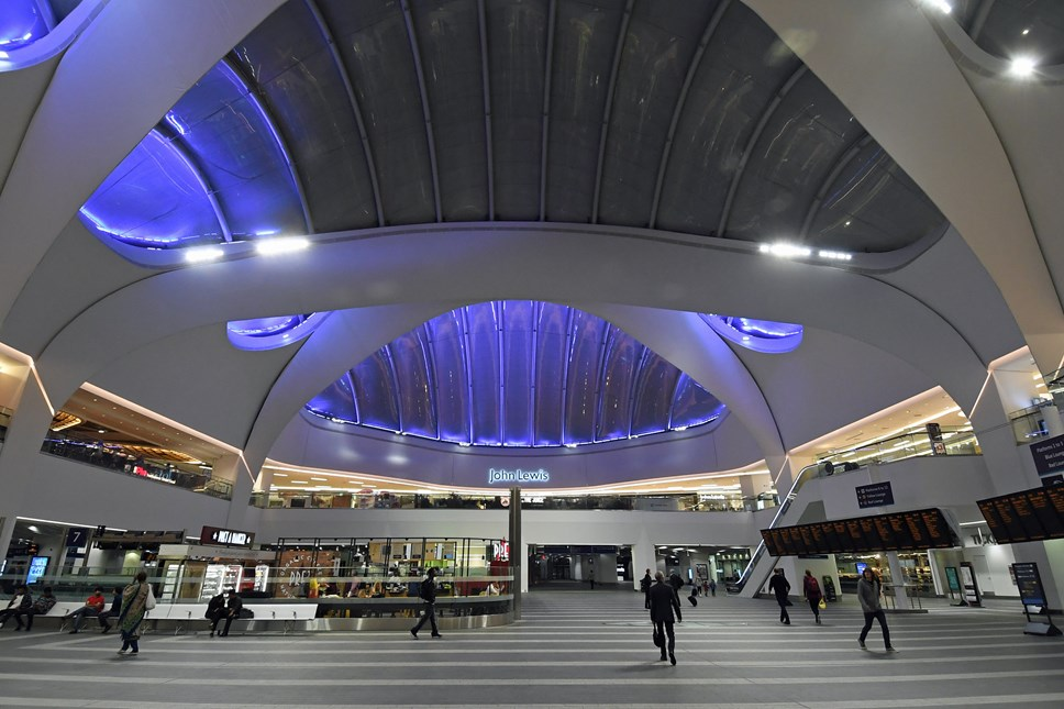 Rail companies run reduced timetable to protect train services and staff: Birmingham New Street concourse at night