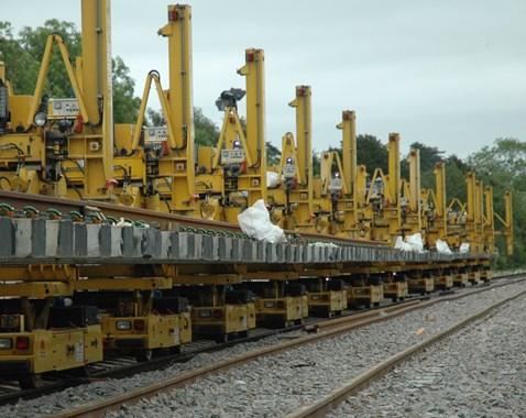 Engineering train installing new sleepers