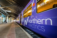 The first Northern Rail electric train to operate between Liverpool Lime Street station and Manchester Airport station