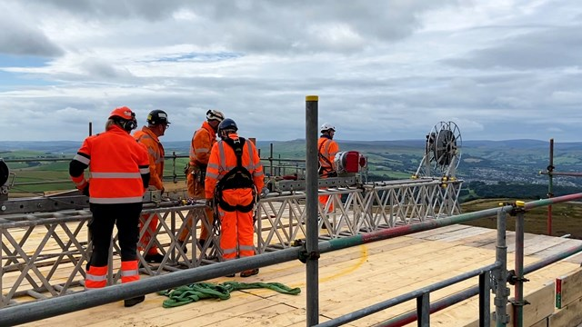 Teams moving the winch system into place on top of Cowburn Tunnel ventilation shaft