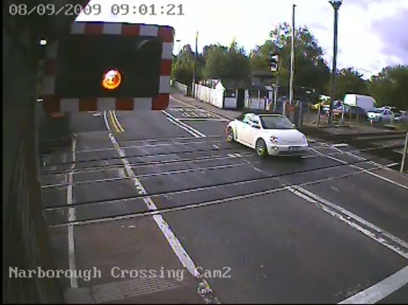 Motorist ignores warning lights at Narborough level crossing, Leicester (1)