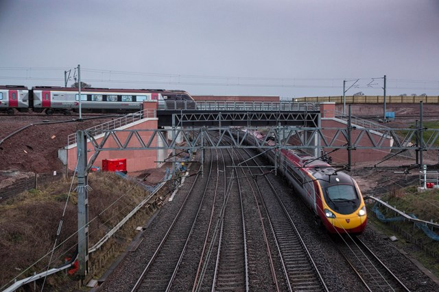 Opened: £250m Norton Bridge flyover – March 2016: A Virgin Trains service passes underneath a CrossCountry service as it passes over the new Norton Bridge flyover, which was brought into use over the Easter 2016 weekend.