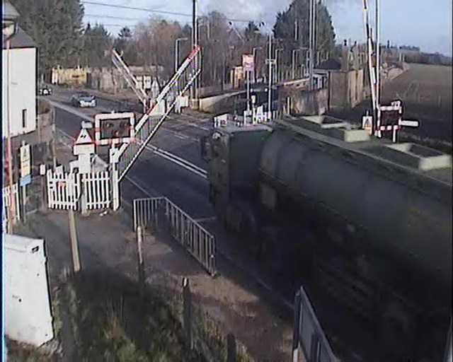 Tanker driver runs the risk at Foxton crossing, Cambs (2)