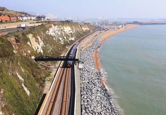 Dover - Shakespeare Beach: A train passes under the new Wellards Way footbridge at Dover - Shakespeare Beach