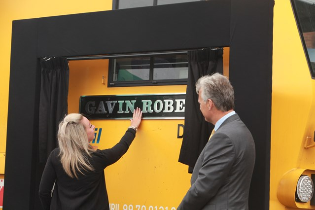 Tributes paid as train named after popular man who died in a car crash: Gavin's partner Meg Williamson touches the plaque as Network Rail's chief executive Mark Carne watches on