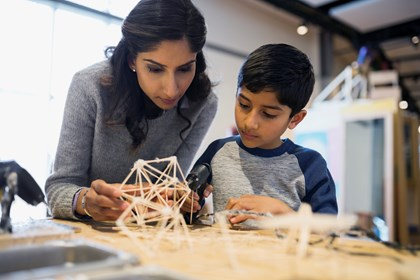 Don't follow in my footsteps, kids told: mother-and-son-assembling-toothpick-model-at-a-science-center-india original