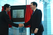 The Chancellor of the Exchequer, George Osborne MP, and Martin Frobisher, area director for Network Rail, unveil a plaque marking the start of work on the Northern Hub at Manchester Airport station