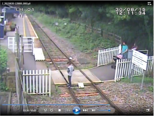 Matlock Bath - Boy texting on his phone while standing on track