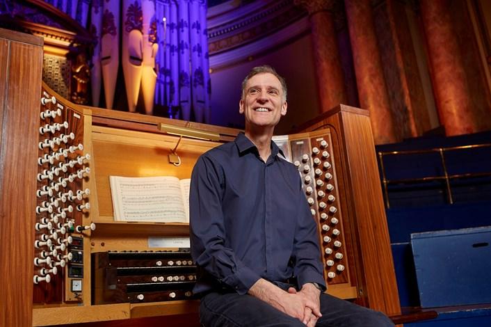 Leeds Town Hall organ recital: Leeds City Organist, Darius Battiwalla with the Leeds Town Hall organ. Credit Justin Slee.