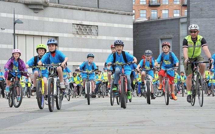 Leeds pupils take to two wheels for Bike Week: bikeweek2015riders.jpg
