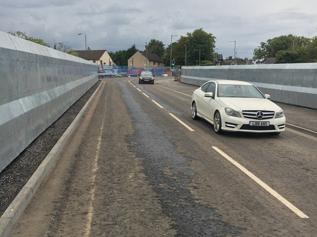 Network Rail open £4m Baillieston railway bridge two weeks early: 15 Aug Muirhead Road First Cars-3