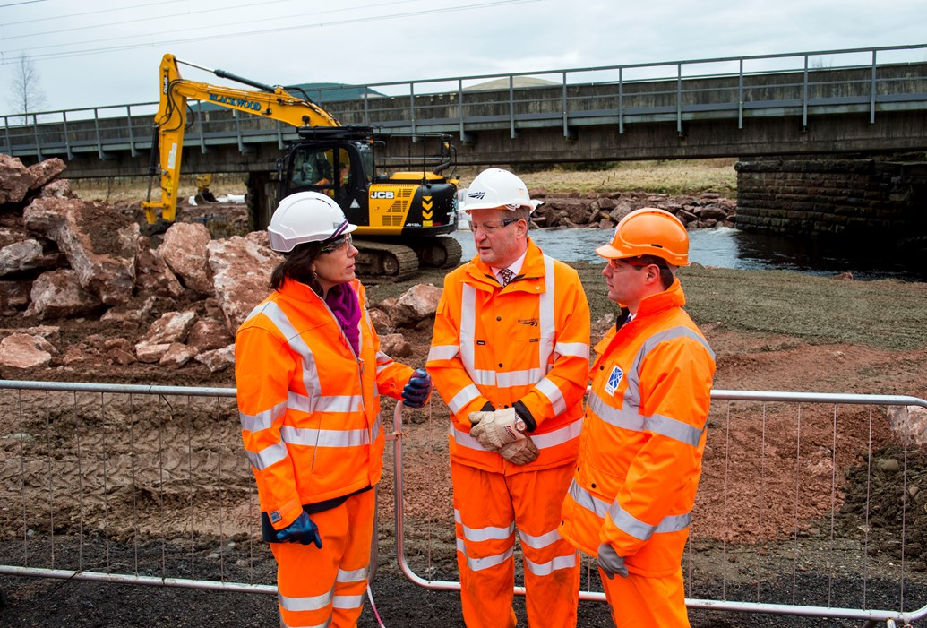 Ministers review West Coast Mainline recovery works: Lamington Viaduct - UK Rail Minister Claire Perry, Network rail MD for ScotLand Phil Verster (centre) and Scottish Transprt Minister Derek Mackay review recovery works
