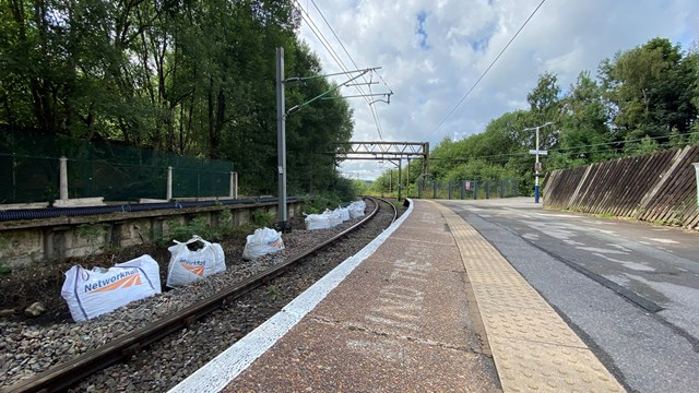 Bags of ballast at Dinting station ready for the August improvement work