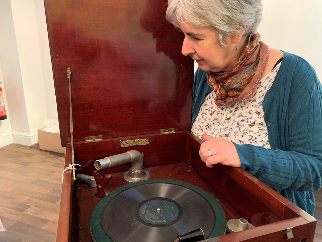 Sounds of Our City: Curator Kitty Ross with a vintage record player which feature sin Sounds of Our City.