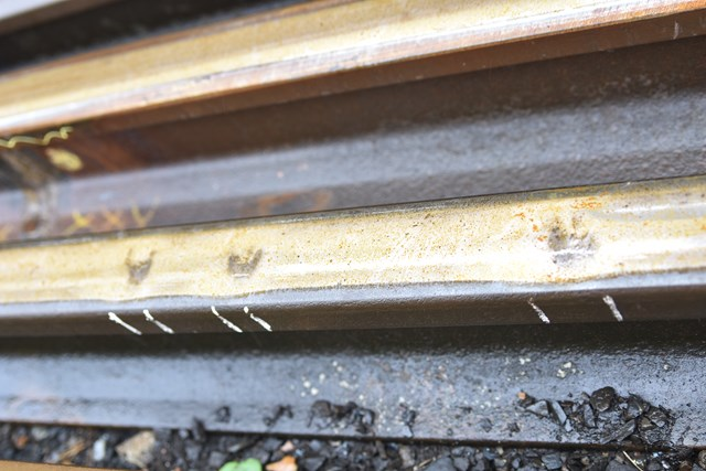 MMT - Defects in the track can appear like small dents, with unseen cracks running deeper through the metal