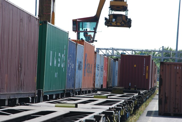 Scottish freight community launches plan to boost freight on the network: Rail freight -  wagons being loaded at a freight yard