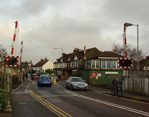 Motorists pass through the crossing as red light warning sequence begins