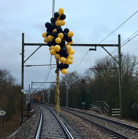 Balloons wrapped around overhead electric lines 2