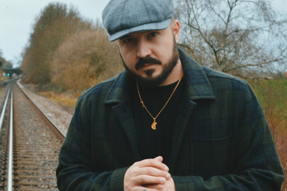 Musician apologises for picture taken on the railway near Basingstoke to promote debut single: Chris Holden - musician
