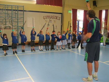 P1 gym class example: Group of P1 pupils taking part in activities in school (pre-covid restriction) - for illustrative purposes.