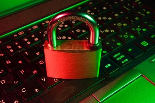 Data security: Padlock sitting on keypad. Copyright free. Photo by Fly D on Unsplash