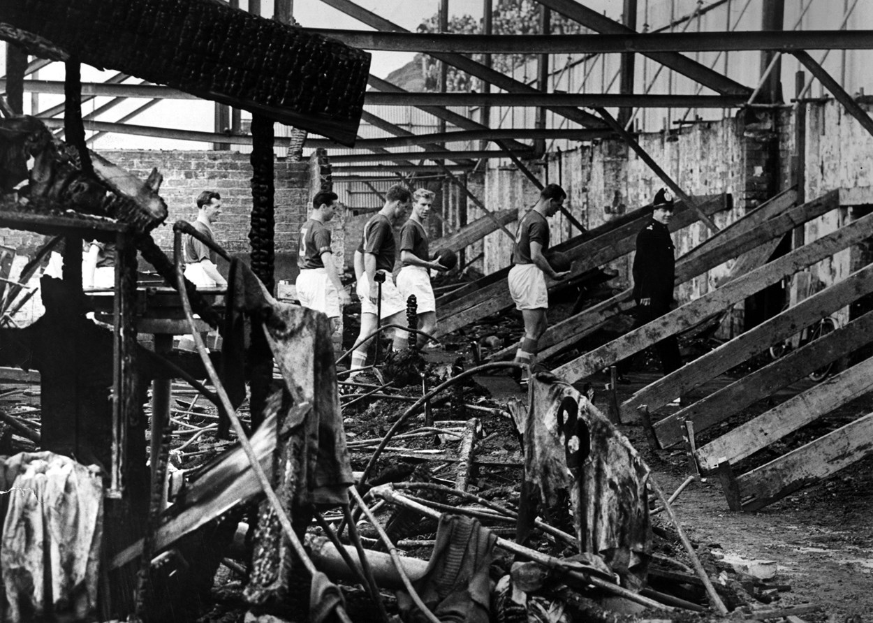 Fire Damage at Elland Road Stadium 1956. Image: © Leeds United Football Club: Members of the 1956 Leeds United Team inspecting the West Stand, which was completely destroyed by fire. Image: © Leeds United Football Club.