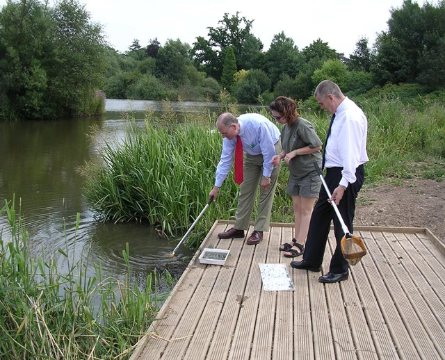 The new 'pond dipping' jetty at Staffordshire Wildlife Trust: Bobby Brady from Network Rail, Shelley Arnold from Staffordshire Wildlife Trust and John McGarry from contractors GTBBJV try out the new jetty at the Trust's Wolseley Centre, near Stafford.