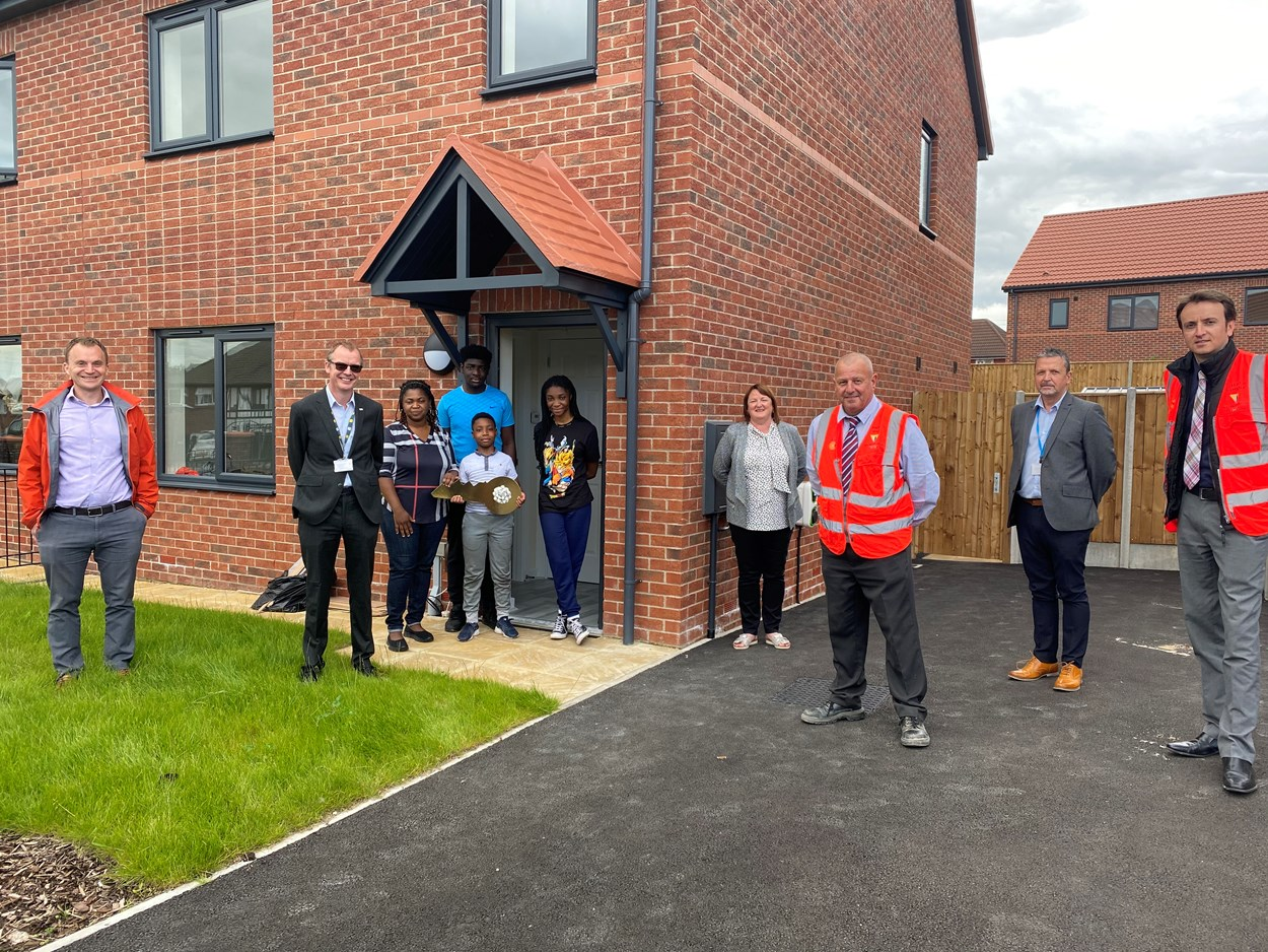Housing growth: Picture caption (L-R-) Mathew Lalley, NPS Group; Gez Tinsdale, head of housing support, Leeds City Council; Members of a family that have moved into one of the new homes; Cllr Debra Coupar; Bob Munden, Leeds City Council technical manager; Mick Hill, senior operations manager, Willmott Dickson and principal  surveyor, Lewis Hemstalk, Wilmott Dickson.