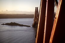 Forth Bridge, looking south.: Pic018: Paint is applied in three layers - a primer, a glass-flake epoxy and a top-coat. It's the top-coat which gives the bridge its colour and its lustre, made to match the red-oxide paint first applied over 121 years ago. The RSPB protected island of Inchgarvie is visible in the background.