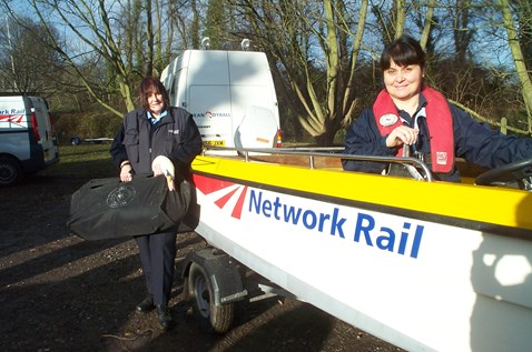 Wendy Hermon and Ellen Bryan with swan rescue boat