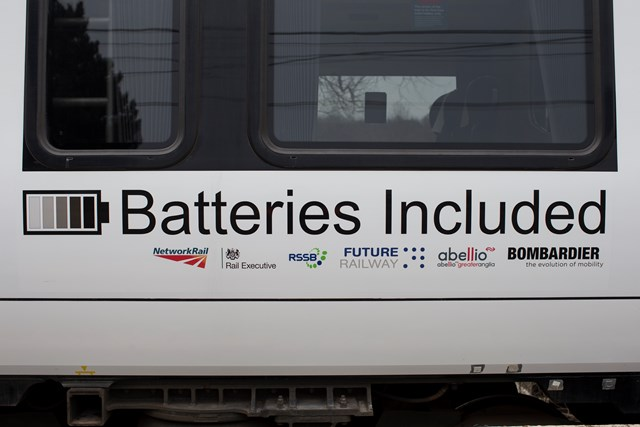 Logos on battery-powered train (IPEMU): The new train contributes to Network Rail's commitment to reduce its environmental impact, improve sustainability and reduce the cost of running the railway by 20 per cent over the next five years. It could ultimately lead to a fleet of battery-powered trains running on Britain's rail network which are quieter and more efficient than diesel-powered trains, making them better for passengers and the environment. Network Rail and its industry partners – including Bombardier, Abellio Greater Anglia, FutureRailway and the Rail Executive arm of the Department for Transport (which is co-funding the project) – recognise the potential for battery-powered trains to bridge gaps between electrified parts of the network and to run on branch lines where it would be too expensive to install overhead electrification.