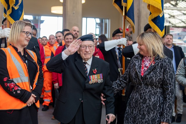 Ernest Horsfall saluting his guard of honour at Preston station