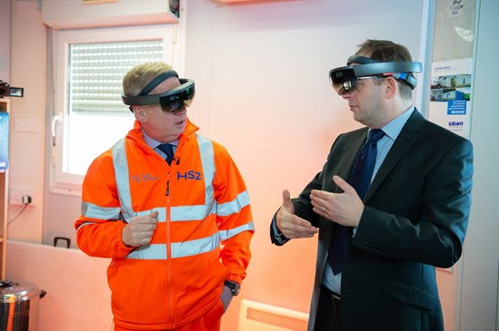 Mark Thurston using augmented reality headset: Mark Thurston at Old Oak Common railway station, London, 9th March 2020. Mark Thurston, CEO HS2, visits the construction activity at the Old Oak Common site, using the augmented reality headset, being interviewed by London media and talking about plans for the Old Oak Common site