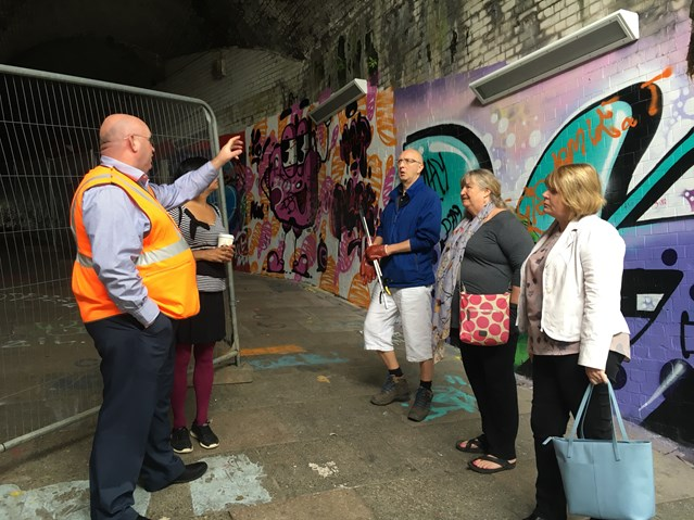 Network Rail showcases transformation of Swansea subway as part of artist-led community scheme: Julie James AM being briefed by Network Rail on new lighting scheme