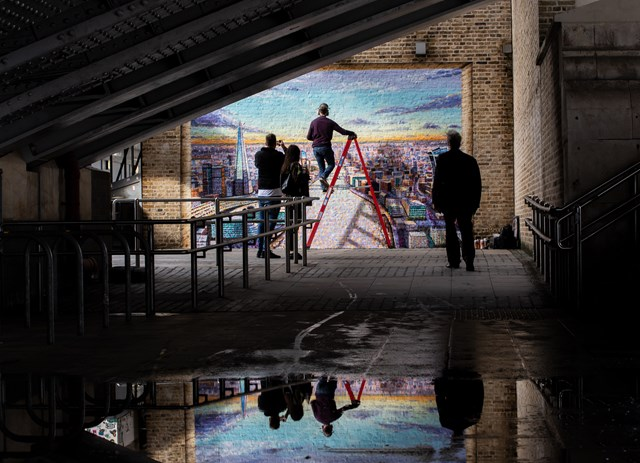 Artist Jimmy C works on his mural at Blackfriars: Artist Jimmy C with his work at Blackfriars
