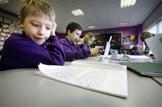 Tackling bureaucracy in schools: Education-class-pupils-reading-primary-school