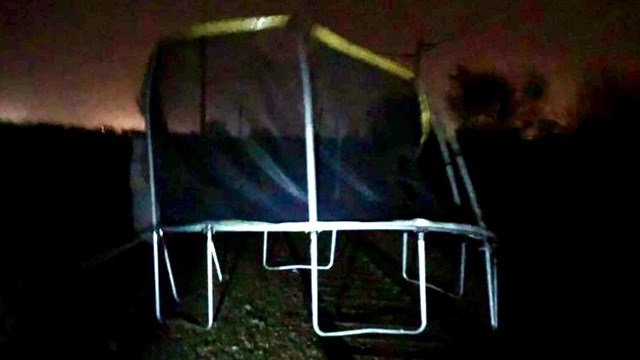 Plea to railway neighbours after airborne trampoline disrupts passengers: Trampoline on track in Hixon, Staffordshire