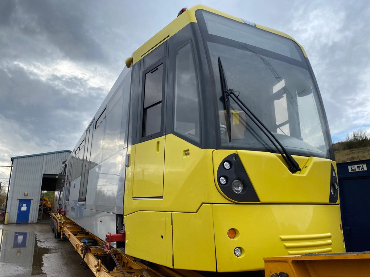 METROLINK 1: An image of the first of 27 new trams being delivered to the Queens Road depot.